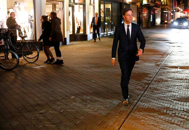 Dutch Prime Minister Mark Rutte of the VVD liberal party walks to parliament in The Hague, Netherlands, March 15, 2017. REUTERS/Michael Kooren