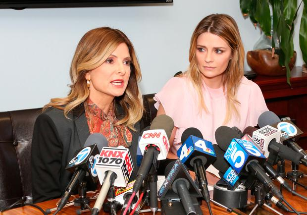 Actress Mischa Barton (R) and her Attorney Lisa Bloom (L) hold news conference on March 15, 2017 in Woodland Hills, California. Barton and her attorney held the conference to address the legal action they are taking against a former boyfriend and a sex tape that allegedly features the actress. (Photo by Paul Archuleta/Getty Images)