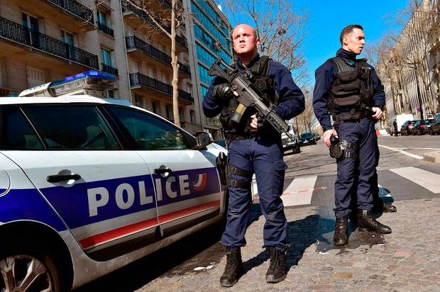 French POlice officers secure the scene near the Paris offices of the International Monetary Fund (IMF) on March 16, 2017 in Paris, after a letter bomb exploded in the premises.AFP PHOTO /Getty Images