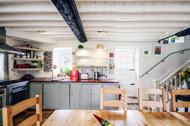 Philip and Delphine Geoghegan's farmhouse: The kitchen, with rust coloured counters