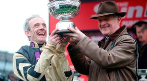 Jockey Ruby Walsh and Trainer Willie Mullins collect the trophy and celebrate their victory in the Sun Bets Stayers' Hurdle during St Patrick's Thursday of the 2017 Cheltenham Festival at Cheltenham Racecourse. PRESS ASSOCIATION Photo. Picture date: Thursday March 16, 2017.