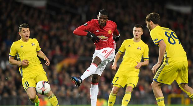 MANCHESTER, ENGLAND - MARCH 16: Paul Pogba of Manchester United takes a shot on goal during the UEFA Europa League Round of 16, second leg match between Manchester United and FK Rostov at Old Trafford on March 16, 2017 in Manchester, United Kingdom. (Photo by Stu Forster/Getty Images)