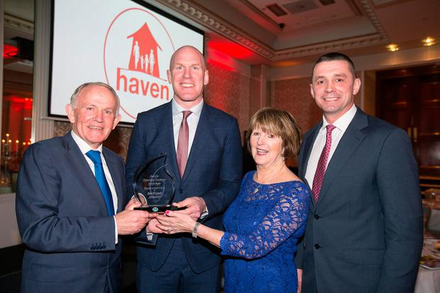 Haven chairman Leslie Buckley and wife Carmel make the presentation to Paul O'Connell helped by Alan Quinlan Photo: Mark Condren