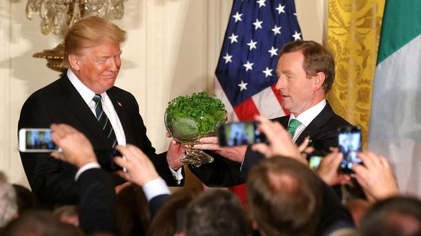Taoiseach Enda Kenny presents US President Donald Trump with the traditional bowl of Shamrock in the White House for St Patrick's day Photo: Gerry Mooney