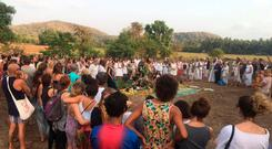 Locals and expats gather for a vigil after her death