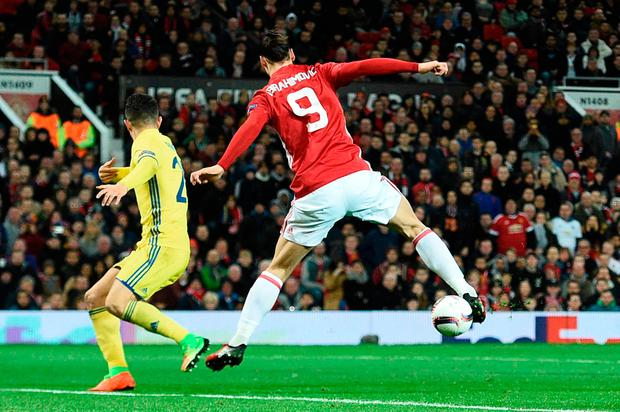 Zlatan Ibrahimovic (R) does a backward flick to lay the ball off for Juan Mata (unseen) to score. Photo: AFP/Getty Images