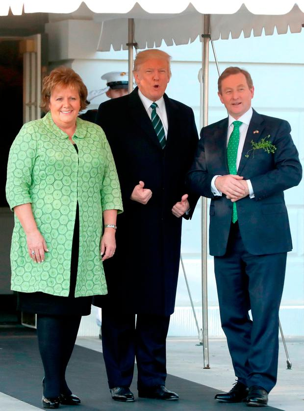 President greets Taoiseach Enda Kenny and his wife Fionnuala Kenny at a reception to honour St Patrick's Day in Washington Photo: PA