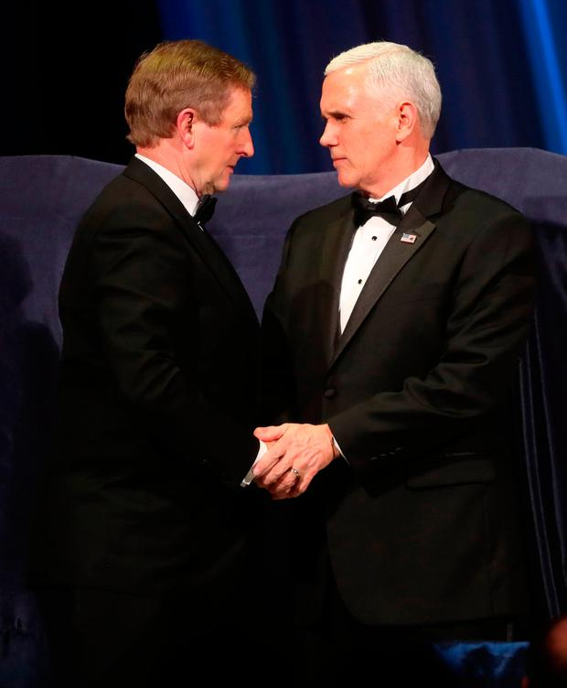 Taoiseach Enda Kenny meets US Vice-President Mike Pence at the Ireland Funds Gala Dinner in Washington Picture: Niall Carson/PA Wire