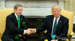 Taoiseach Enda Kenny shakes hands with President Donald Trump in the Oval Office. Photo: Gerry Mooney