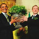 Enda Kenny presents a bowl of shamrock to Barack Obama. Photo: Leslie E. Kossoff/LK Photos
