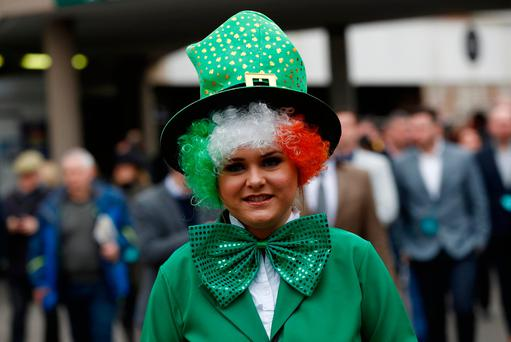 A racegoer in St Patrick's Day fancy dress during the Cheltenham Festival. Photo: Reuters