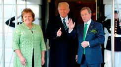 U.S. President Donald Trump welcomes Enda Kenny (R) and Kenny's wife Fionnuala Kenny (L) for a St. Patrick's Day reception at the White House in Washington. REUTERS/Jonathan Ernst