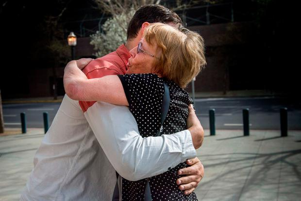 Marianne Quinn the mother of Aaron Quinn, one of Matthew Muller's victims, hugs one of her son's friends Thursday, March 16, 2017, in Sacramento, Calif. (Hector Amezcua/The Sacramento Bee via AP)