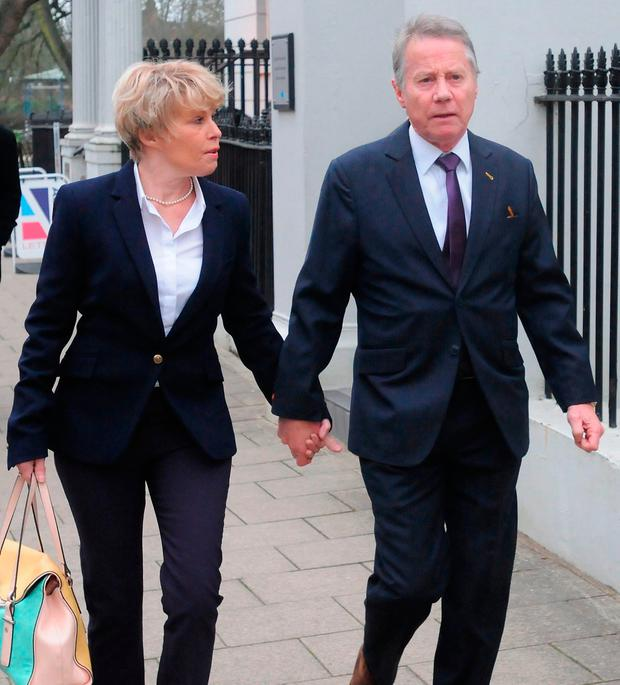 Tony and Julie Wadsworth arrive at Warwick Crown Court in Leamington Spa, they have have denied outraging public decency after allegedly having sex against a tree in full view of a group of young boys. Matthew Cooper/PA Wire