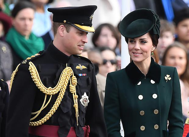 Britain's Prince William, Duke of Cambridge, (L) and his wife Britain's Catherine, Duchess of Cambridge visit the Irish Guards during a St Patrick's Day parade at Cavalry Barracks in Hounslow, west London on March 17, 2017. / AFP PHOTO / Justin TALLIS (Photo credit should read JUSTIN TALLIS/AFP/Getty Images)