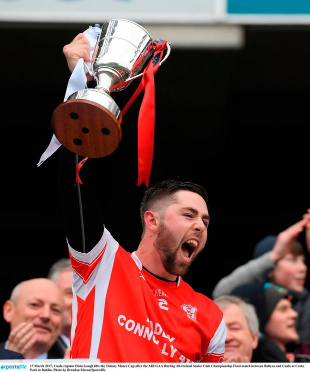 Cuala captain Oisín Gough lifts the Tommy Moore Cup