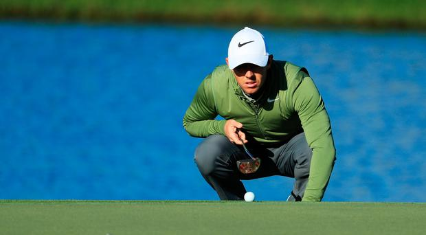 Rory McIlroy of Northern Ireland lines up a putt on the 13th green during the second round of the Arnold Palmer Invitational Presented By MasterCard on March 17, 2017 in Orlando, Florida. (Photo by Richard Heathcote/Getty Images)