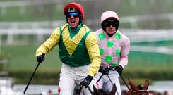 Robbie Power shows his delight aboard Sizing John after their victory in yesterday's Cheltenham Gold Cup with Djakadam and Ruby Walsh in the background. Photo: Reuters / Stefan Wermuth