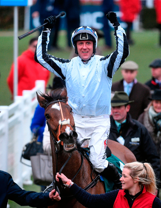 Robbie Power celebrates as he enters the parade ring after winning the Johnny Henderson Grand Annual Challenge Cup Handicap Steeple Chase. Photo by Cody Glenn/Sportsfile