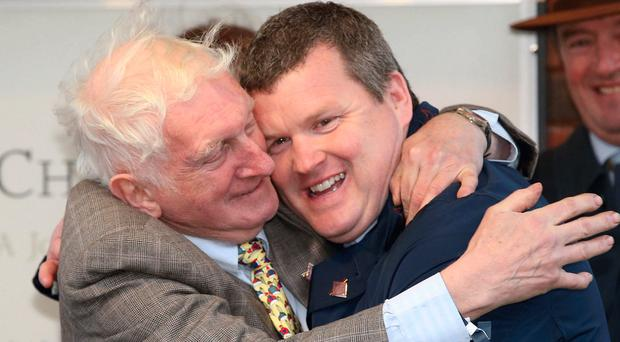 Gordon Elliott is congratulated by legendary former trainer Martin Pipe (left) after taking the Irish Independent leading trainer award at Cheltenham.
