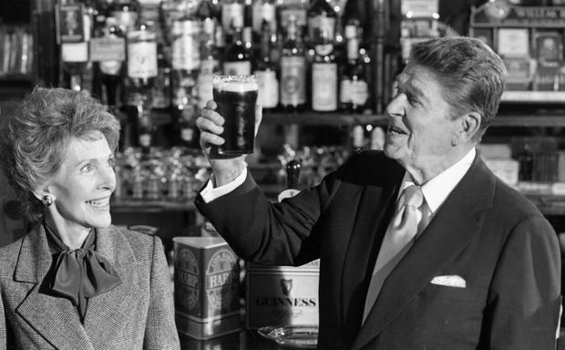 Despite sustained opposition to the visit by Ronald Reagan (pictured inset in a pub in Ballyporeen, Co Tipperary, in 1984), he surprised people by mentioning Northern Ireland every day he was here. Photo: INM