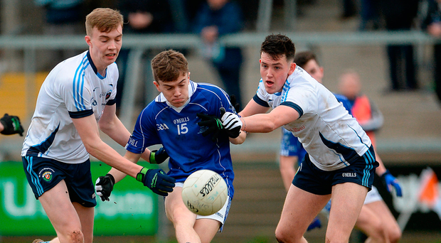 Aaron Gribben of St. Colman's College in action against Daniel Bradley and Sean Kelly of St. Mary's Grammar School. Photo by Oliver McVeigh/Sportsfile