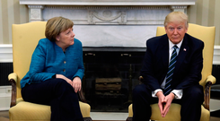President Donald Trump meets with German Chancellor Angela Merkel in the Oval Office of the White House in Washington yesterday. Photo: AP/Evan Vuccifrom