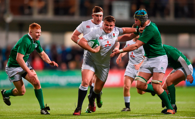 England's Ciaran Knight fends off Fineen Wycherley. Photo by Eóin Noonan/Sportsfile