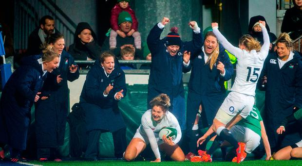 England's Amy Wilson Hardy (centre) scores the opening try as her team-mates celebrate. Photo: PA