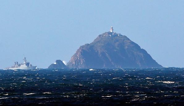 A Navy vessel off Black Rock lighthouse, where the search for Rescue 116 is now being concentrated Picture: Collins