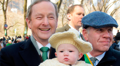 Taoiseach Enda Kenny with seven-month-old Savanah Marie who was at the St Patrick's Day parade in New York with her grandfather Mark Cassels. Photo: Gerry Mooney