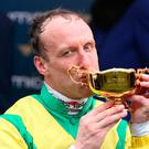 Jockey Robbie Power kisses the Gold Cup after winning on Sizing John Photo: Damien Eagers
