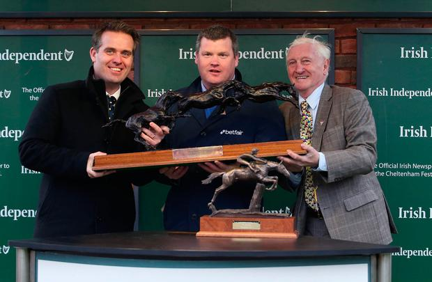 Gordon Elliott, who was named the Irish Independent leading trainer, receives the trophy from Geoff Lyons, Commercial Director at INM, and former trainer Martin Pipe Picture: Damien Eagers
