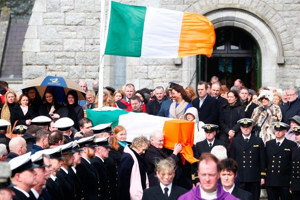 The family of Captain Dara Fitzpatrick carry her coffin out of the church. Photo: David Conachy