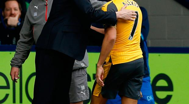 Arsenal's Alexis Sanchez with manager Arsene Wenger as he is substituted