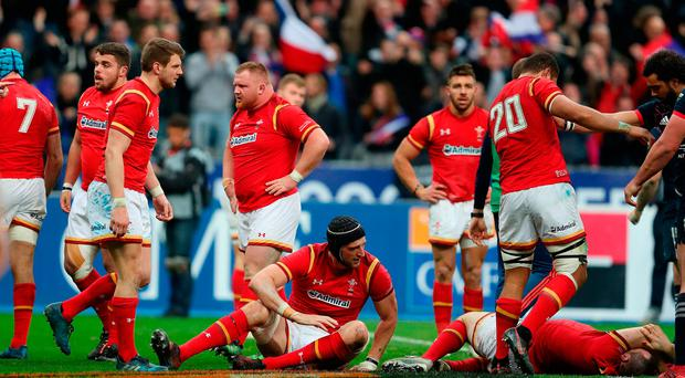 Wales stand dejected after conceding a last minute try