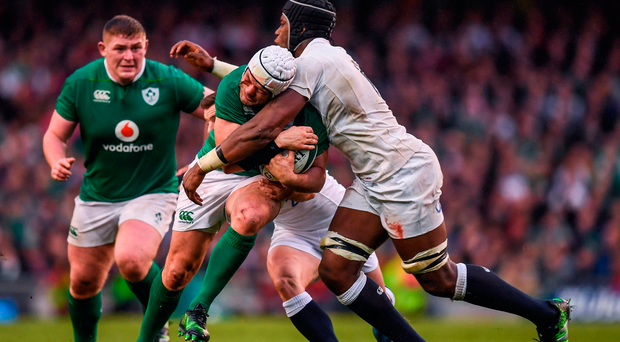 Rory Best of Ireland in action against Ben Youngs and Maro Itoje, right, of England