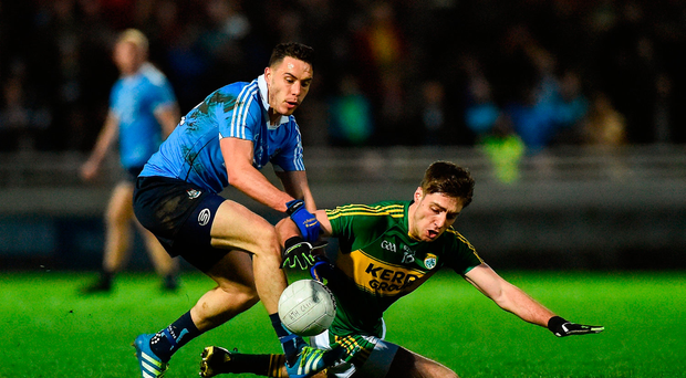 Shane B. Carthy of Dublin in action against Adrian Spillane of Kerry