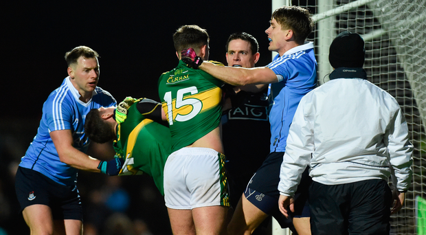 Paul Geaney, left, and Jack Savage of Kerry tussle off the ball with Philip McMahon, Michael Fitzsimons and Stephen Cluxton of Dublin during the Allianz Football League Division 1 Round 5 match between Kerry and Dublin at Austin Stack Park in Tralee, Co Kerry. Photo by Diarmuid Greene/Sportsfile
