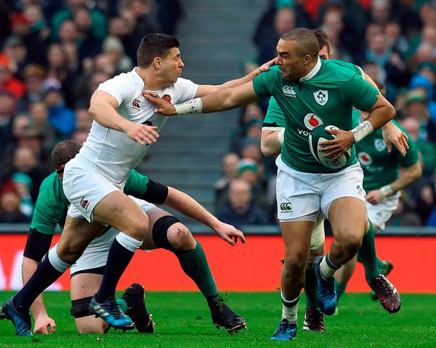 England's Ben Youngs tackles Ireland's Simon Zebo. Photo: PA Wire