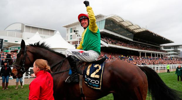 Robbie Power celebrates with Sizing John after winning the Gold Cup on Friday. Photo: David Davies/PA