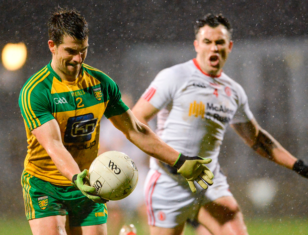 Donegal's Paddy McGrath in action against Tyrone's Cathal McCarron. Photo: Oliver McVeigh/Sportsfile
