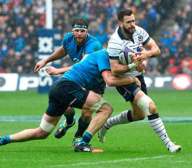 Scotland's Alex Dunbar is tackled by Italy's George Biagi. Photo: Ian Rutherford/PA Wire