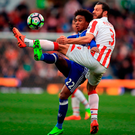 Willian (left) battles with Erik Pieters in Chelsea's victory at Stoke — a result that lifted the Londoners 13 points clear at the top of the Premier League table. Photo: Mike Egerton/PA
