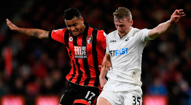 Swansea City's Stephen Kingsley in action again Bournemouth's Joshua King. Photo: Tony O'Brien/Reuters