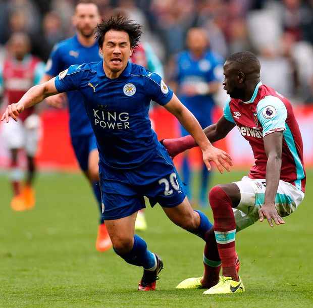 West Ham United's Cheikhou Kouyate in action with Leicester City's Shinji Okazaki. Photo: John Sibley/Reuters