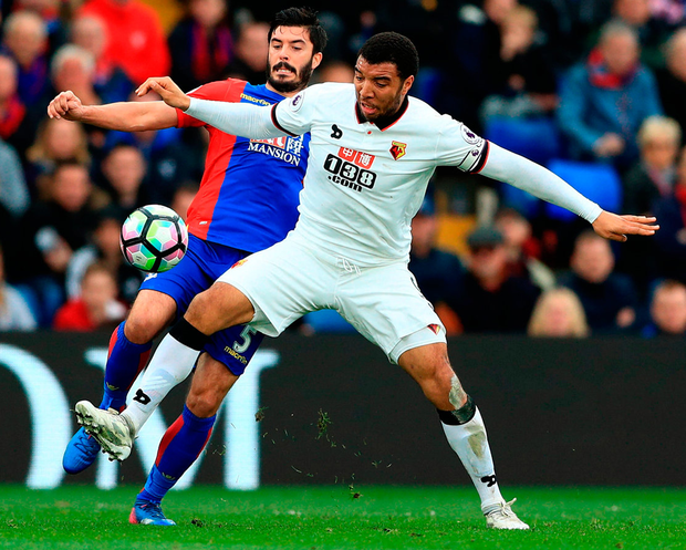 Crystal Palace's James Tomkins (left) and Watford's Troy Deeney (right) battle for the ball. Photo: John Walton/PA