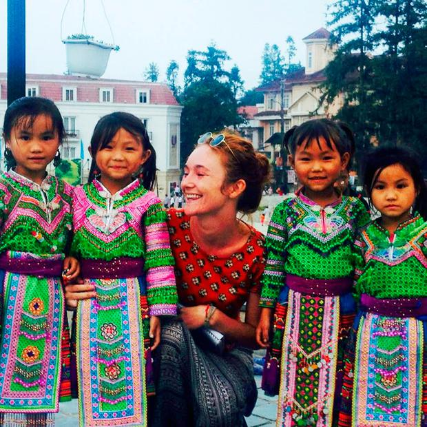 Danielle McLaughlin pictured with local children during an earlier trip to Asia, when she spent time in Thailand