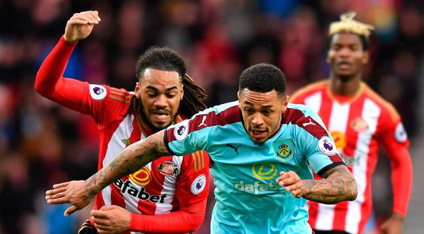 Burnley's Andre Gray in action with Sunderland's Jason Denayer. Photo: Anthony Devlin/Reuters