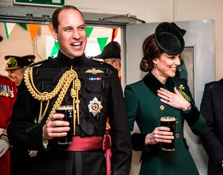LETTING IT ALL HANG OUT: The Duke and Duchess of Cambridge went for pints of Guinness when they here hosted by soldiers of the 1st Battalion Irish Guards in their canteen following their St Patrick's Day parade at Cavalry Barracks, Hounslow. Photo: Yuk Moi/PA